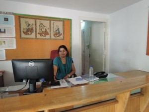 Surita, the warm and inviting Saptiparni receptionist
